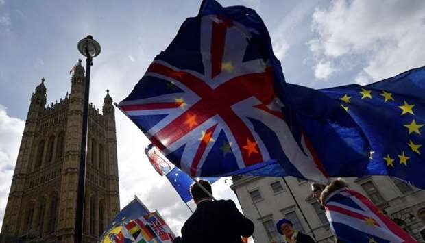 Anti-Brexit protesters gather opposite the Houses of Parliament, in London, Britain