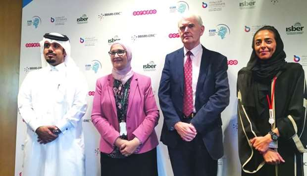 QF, Qatar Biobank, and Ooredoo officials at the event.