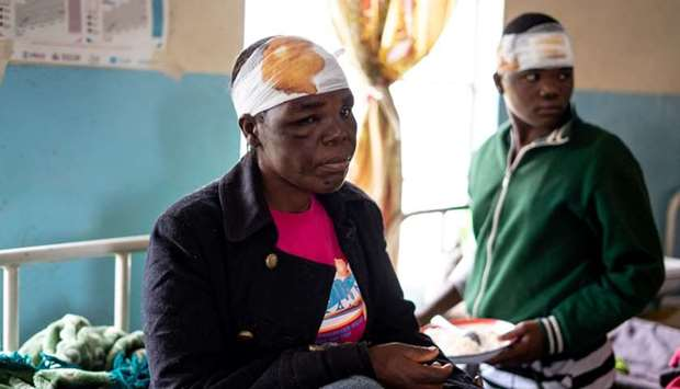 Jane Chitsuro, a cyclone survivor, sits on a hospital bed at Chimanimani Rural district hospital