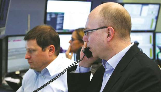 Traders work at the Frankfurt Stock Exchange. The DAX 30 powered ahead by 1.1% at 11,788.41 after a