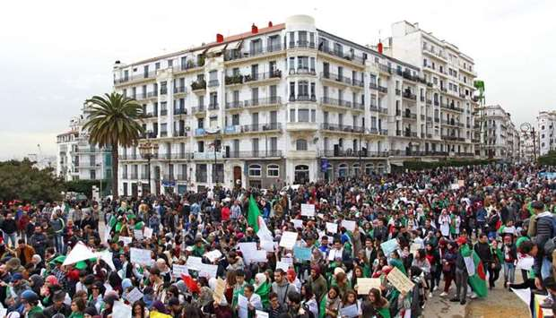 Algerians carry placards and national flags as they take part in a demonstration in the capital Algi