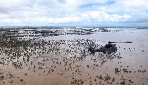 An Oryx helicopter from the SANDF flies during an air relief drop mission over the flooded area arou