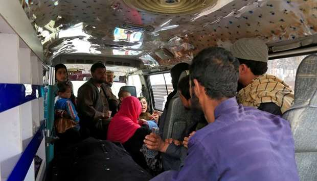 A family reacts inside an ambulance after they lost a family member after multiple explosions in Kab