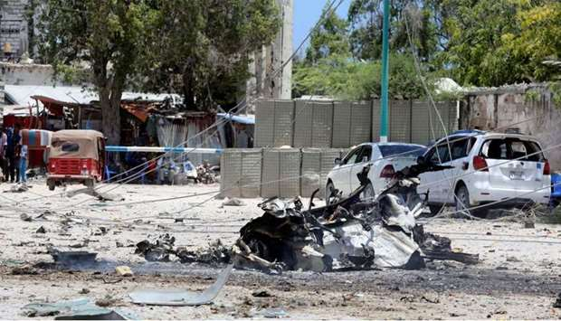 A general view shows the scene of a suicide explosion after al-Shabaab militia stormed a government