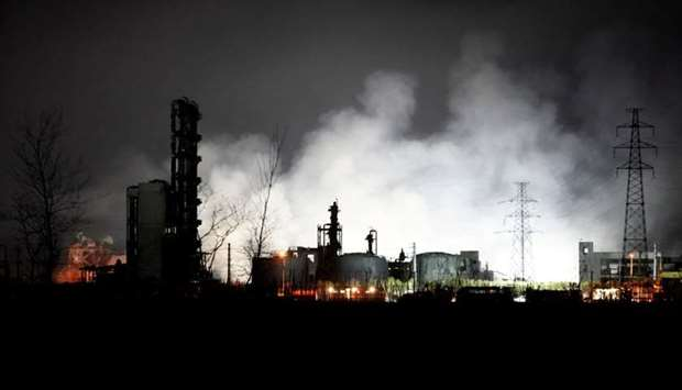 Smoke billows from the pesticide plant owned by Tianjiayi Chemical following an explosion, in Xiangs