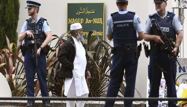 Members of the local Muslim community wait to enter the Al Noor mosque as it is reopened in Christch