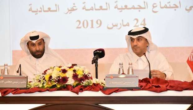 Al-Kaabi (left) and QIIB deputy CEO Jamal al-Jamal at the bank's extraordinary general assembly here