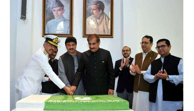 A cake-cutting ceremony at the Pakistan embassy to mark the National Day.