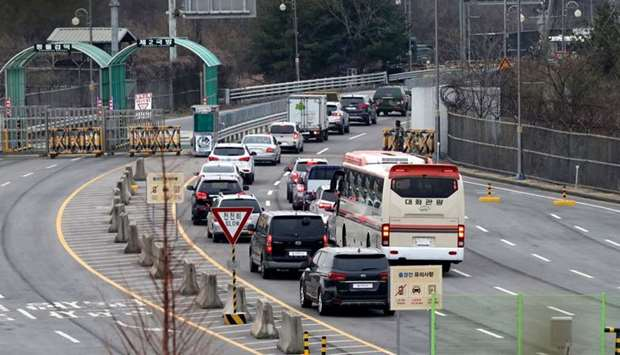 Vehicles carrying South Korean officials of the inter-Korean liaison office head to North Korea's bo