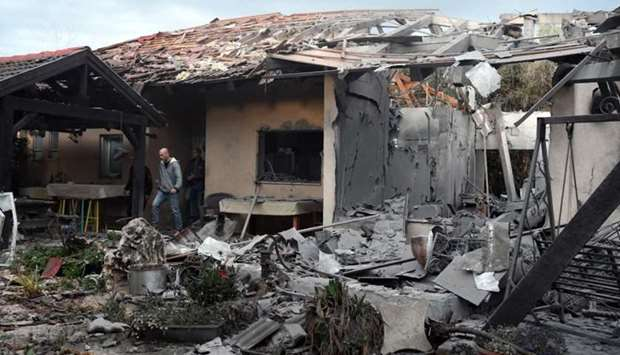 A damaged house that was hit by a rocket can be seen north of Tel Aviv, Israel