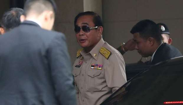 Thailand's Prime Minister Prayuth Chan-ocha arrives at the Government House a day after the general