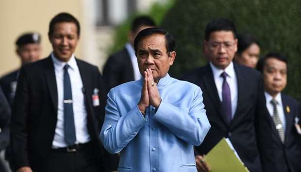 Thailand's Prime Minister Prayut Chan-O-Cha (C) arrives at the Government House for a cabinet meetin