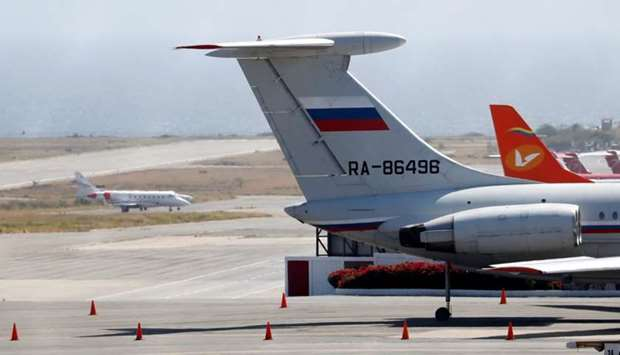 An airplane with the Russian flag is seen at Simon Bolivar International Airport in Caracas, Venezue