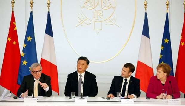 (From L) European Commission President Jean-Claude Juncker, Chinese President Xi Jinping, French Pre