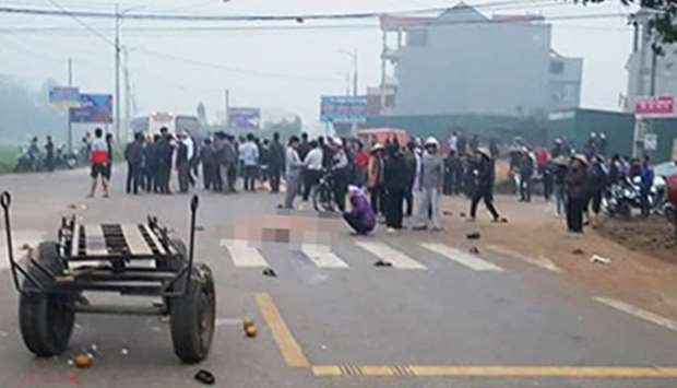 Scene after a bus rammed into pedestrians during a funeral procession in Vinh Phuc Province, Vietnam