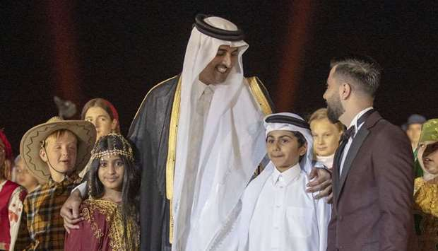 His Highness the Amir Sheikh Tamim bin Hamad al-Thani with children at the opening of the National M