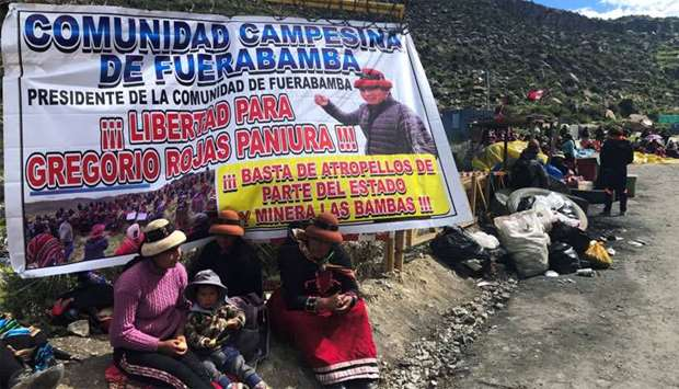 Demonstrators block a road access to a copper mine during a protest in Fuerabamba, Apurimac, Peru