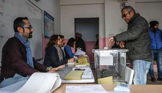 A man casts his vote at a polling station in Istanbul
