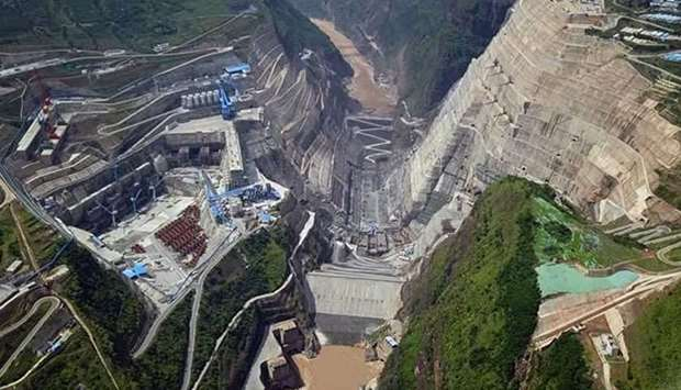 Construction began on the main structure of a 2.24-GW hydropower station on the Jinsha River