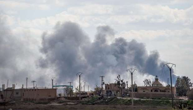 Smoke billows after shelling on the Islamic State (IS) group's last holdout of Baghouz, in the easte