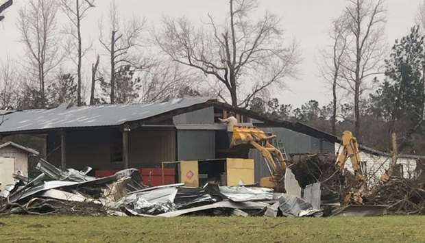 Debris are seen where two back-to-back tornadoes touched down in Lee County near Beauregard, Alabama
