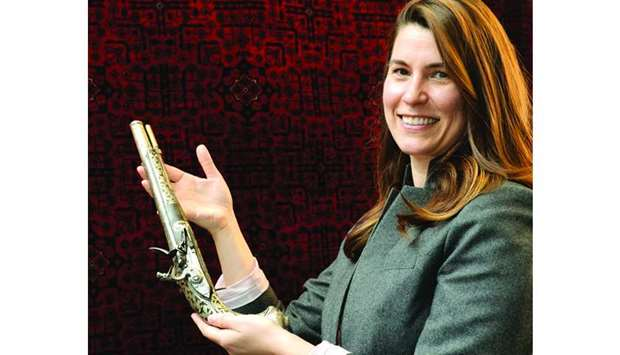 AlBahie Auction House director Jennifer Bishop shows one of the items for the Arts of the Islamic Wo