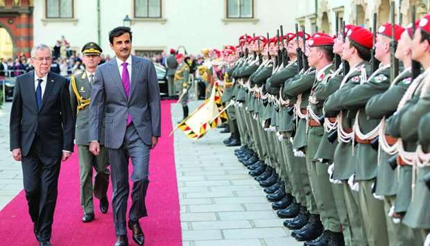 His Highness the Amir Sheikh Tamim bin Hamad al-Thani inspects a guard of honour with Austrian Presi
