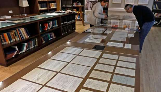 Visitors look at some of Albert Einstein's manuscripts on display in the Givat Ram Hebrew University
