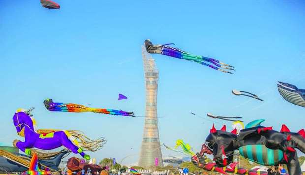 Kites of various kinds being flown at Aspire Park.