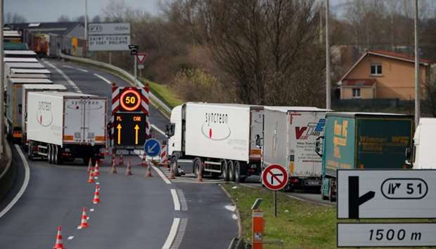 Trucks queue on the Dunkirk-Calais motorway as French Customs Officers increase their controls on tr