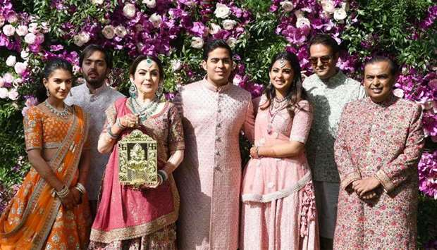 Akash Ambani (C), son of Indian businessman Mukesh Ambani (R) and businesswoman Nita Ambani (3rd L),