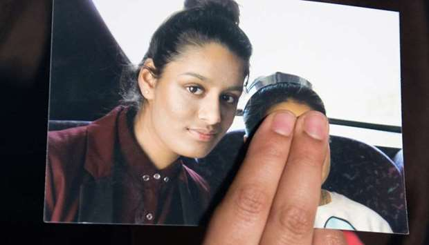 Renu Begum, sister of teenage British girl Shamima Begum, holds a photo of her sister as she makes a