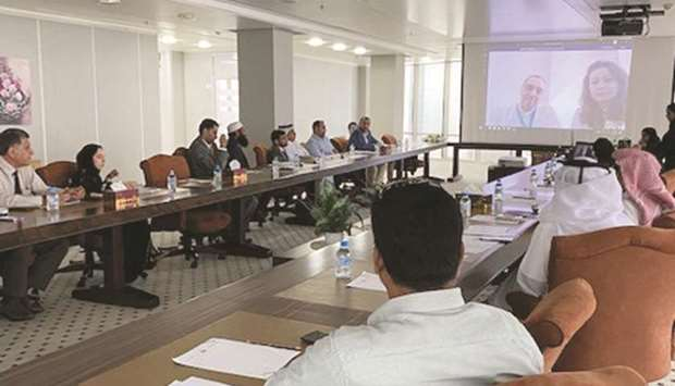 Workers in the refrigeration and air-conditioning sector in Qatar attending a meeting organised by t