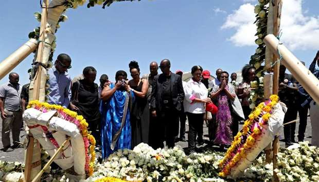 FILE PHOTO: United Nations workers mourn their colleagues during a commemoration ceremony for the vi