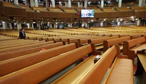 An empty grand hall of a church is pictured during a service in Seoul, South Korea