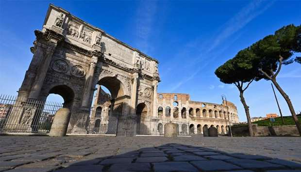 A general view shows a deserted area by the Arch of Constantine (L) and a closed Colosseum monument