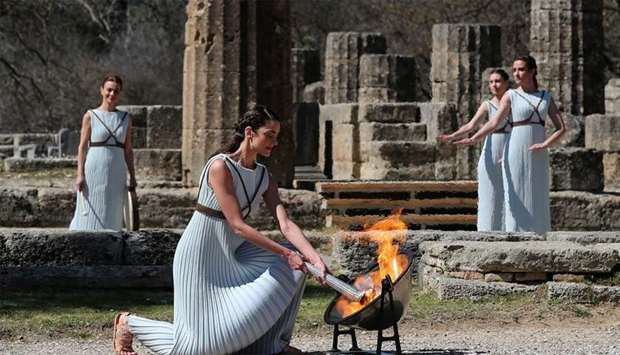 Greek actress Xanthi Georgiou, playing the role of High Priestess, lights the flame during the Olymp
