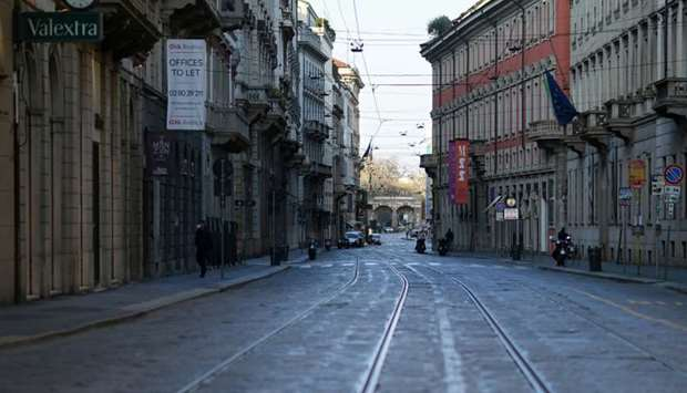 The deserted Via Manzoni street is seen on the fourth day of an unprecedented lockdown across of all