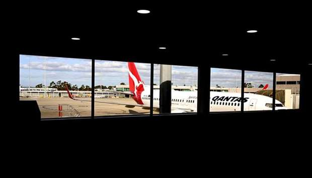 A plane sitting at a gate at Tullamarine Airport in Melbourne