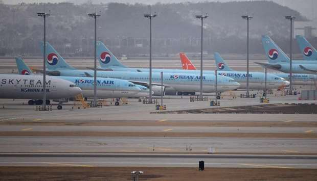 Commercial aircraft are seen parked on the tarmac at Incheon international airport, west of Seoul