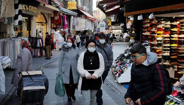 People wear protective face masks due to coronavirus concerns in Istanbul, Turkey