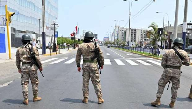 Peruvian army soldiers control traffic in Lima on March 16, 2020, in an attempt to persuade the popu