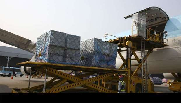 Cargo is unloaded from a Korean Air Lines freight plane arriving from China at the company's cargo t