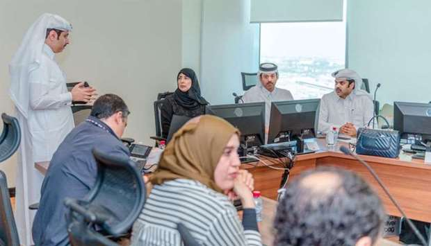 HE Dr Hanan Mohamed al-Kuwari being briefed during her visit to the Covid-19 Surveillance Unit. Pict