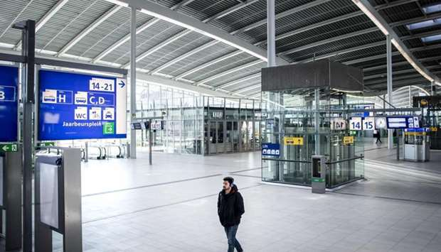 A man walks inside Utrecht Central Station in Utrecht, the Netherlands