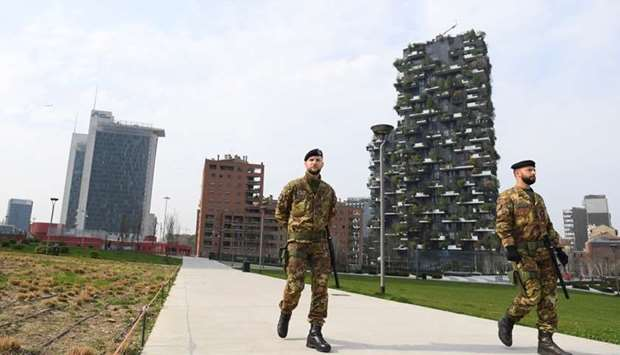 Italian army soldiers patrol streets after being deployed to the region of Lombardy to enforce the l