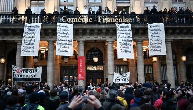 Actors with costumes and employees of the Comedie Francaise perform on the balconies of the Comedie