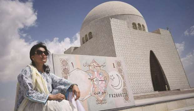 DOHA TO KARACHI: Mala with her artwork (a one rupee currency note) that she carried to the mausoleum