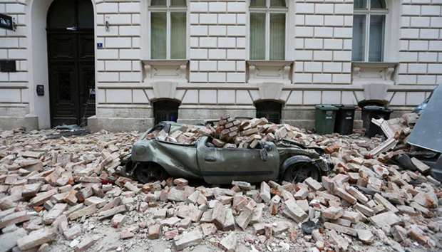 A destroyed car is seen following an earthquake, in Zagreb, Croatia