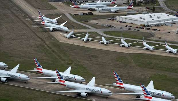 American Airlines passenger planes crowd a runway where they are parked due to flight reductions mad